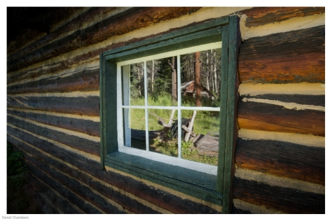 Cabin Window Reflection - ©Derek Chambers